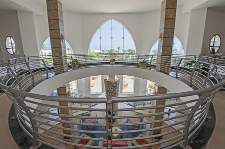 mezzanine: Abstract view of hotel lobby showing interior design with circular mezzanine Stock Photo