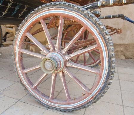 horse drawn carriage: Closeup detail of wheel on old vintage horse drawn carriage