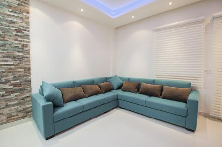 Corner sofa with cushions in luxury apartment living room Standard-Bild