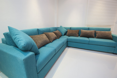 furniture detail: Corner sofa with cushions in luxury apartment living room Stock Photo