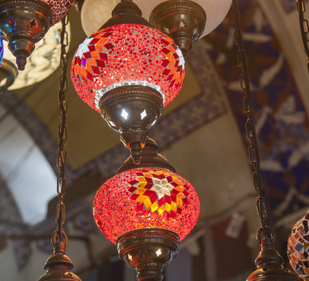 glass ceiling: Ornate glass ceiling lights hanging at a bazaar market souk stall