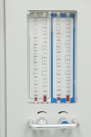 medical ventilator: Closeup detail of flow-meter gauge on medical hi-tech anesthetic machine in health care center hospital