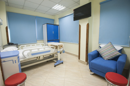 Bed in a private hospital medical center ward room