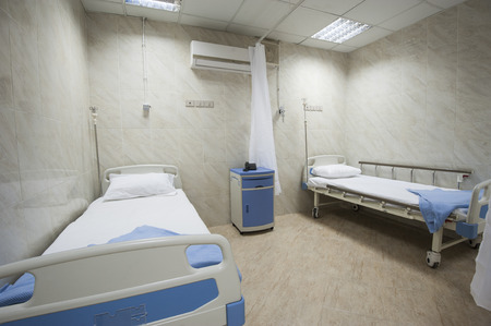 Two beds in a private hospital medical center ward room