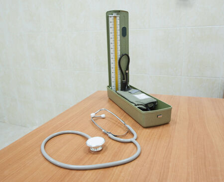 blood pressure gauge: Doctors stethoscope and blood pressure gauge on desk in a medical center hospital