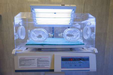 Closeup of infant incubator technology in a medical center hospital Stock Photo