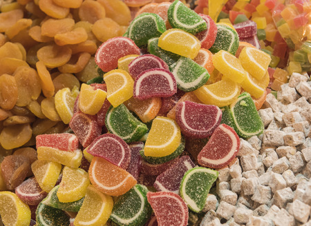 market stall: Closeup detail of colorful sugary boiled fruit sweets on display at a market stall