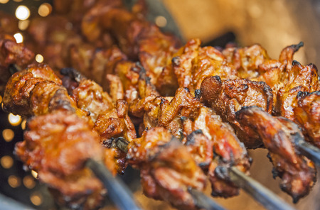 Closeup of chicken tikka kebabs cooking on skewers in indian tandoori oven Stock Photo