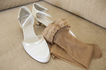 hold ups: Pair of womens brides wedding shoes and beige hold-up thigh highs nylons stockings