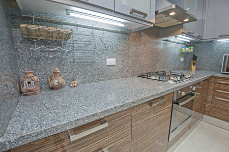 kitchen counter top: Interior design decor of kitchen in luxury apartment with appliances