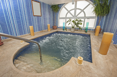 pool rooms: Large jacuzzi pool in room of luxury health spa center with candles