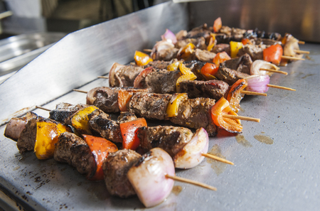 buffet: Closeup detail of beef shish kebab skewers on a grill at a hotel restaurant buffet