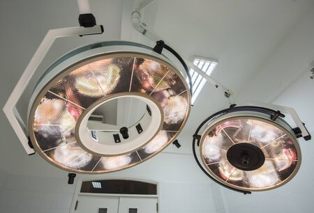 powered: High powered circular surgery lights in a hospital operating room