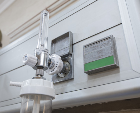 medical center: Closeup detail of an oxygen flow-meter gauge with nozzle in medical center hospital