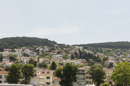 residential housing: View of rural Princes Island of Burgazada hillside with luxury residential housing on coast