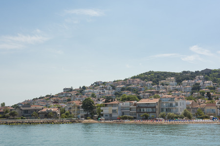 View of rural Princes Island of Kinaliada hillside with luxury residential housing on coast Stock Photo