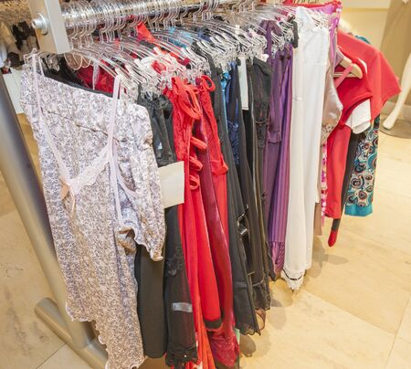 nightwear: Display of womens lingerie nightwear homewear clothing hanging in clothes shop