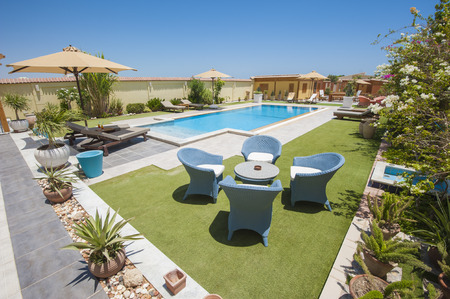 show garden: Luxury villa show home swimming pool in a tropical resort