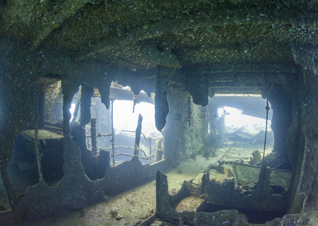 corroding: Interior section of a large underwater shipwreck