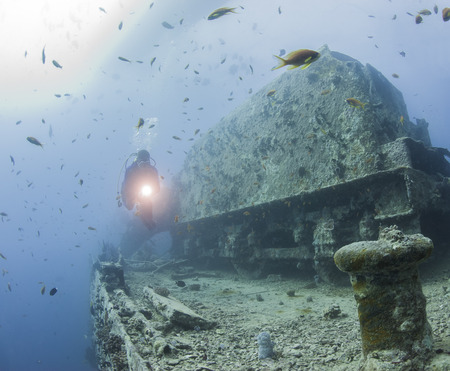 shipwreck: Scuba diver exploring a large underwater shipwreck