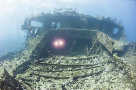 superstructure: Scuba divers exploring a large underwater shipwreck