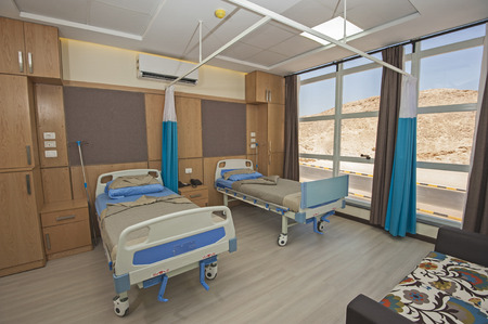 private hospital: Hospital beds in a private hospital ward with sofa