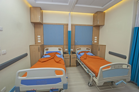 private hospital: Hospital beds in a private hospital ward