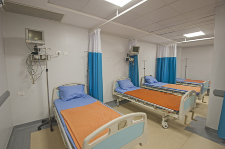 surgery table: Hospital beds in a private hospital intensive care ward with monitoring equipment