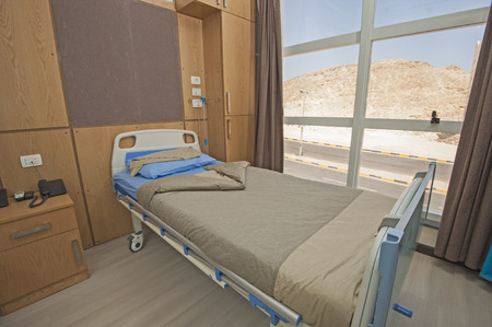 private hospital: Hospital bed in a private hospital ward Stock Photo
