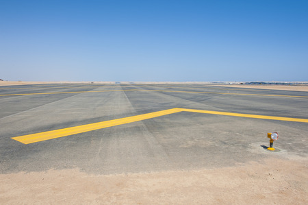 airfield: Row of approach lights off the end of an airfield airport runway Stock Photo