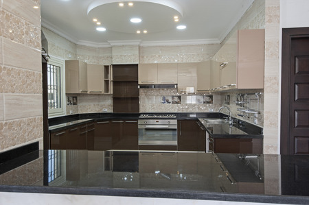 kitchen counter top: American style kitchen area of a luxury apartment showing interior design