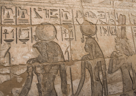 hieroglyphic: Ancient Egyptian hieroglyphic carvings on a temple wall at Medinat Habu in Luxor Stock Photo