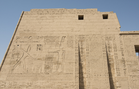 hieroglyphic: Egyptian hieroglyphic carvings on large entrance pylon wall at the Temple of Medinat Habu