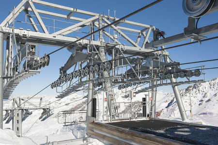 car lift: Top of a large alpine cable car lift on mountain in ski resort Stock Photo