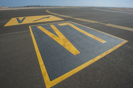 directional sign: Directional sign markings on the tarmac of runway at a commercial airport
