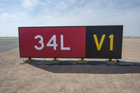 directional sign: Directional sign markings by the runway at a commercial airport