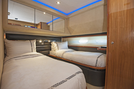 motor yacht: Twin beds in cabin of a luxury private motor yacht