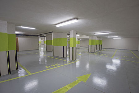 Interior of a new modern underground carpark beneath an apartment building with columns