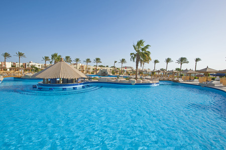 hotel resort: Large swimming pool with bar at a luxury tropical hotel resort