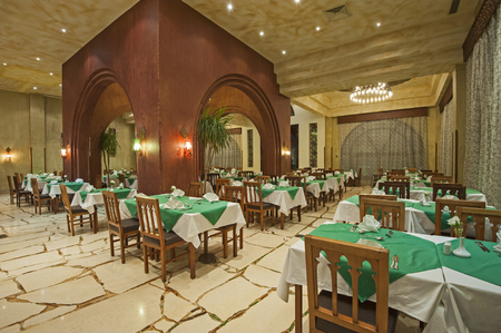 dining room: Interior design of a luxury hotel restaurant dining area with ornate decor Stock Photo