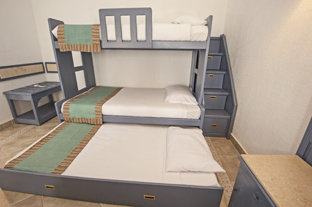 bunk: Space saving bunk beds in family bedroom storage concept idea with steps