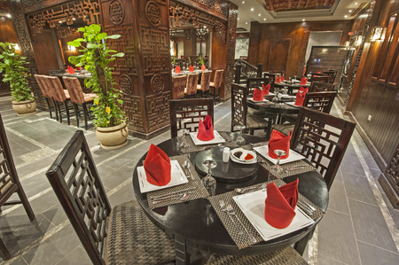 wood pillars: Interior design of a luxury hotel Asian restaurant dining area with ornate decor