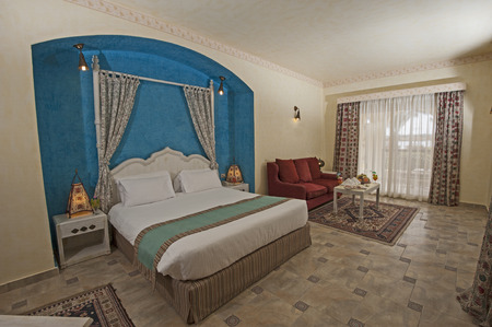 hotel suite: Double bed in suite of a luxury hotel with curtains