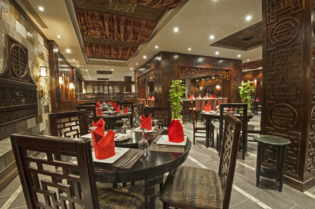 ceiling plate: Interior design of a luxury hotel Asian restaurant dining area with ornate decor