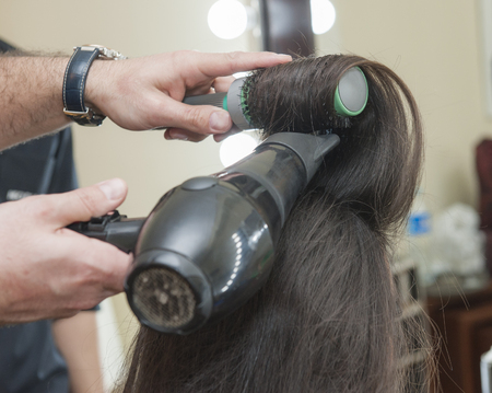 blow drier: Closeup detail of female womens hair styling being styled at hairdresser salon