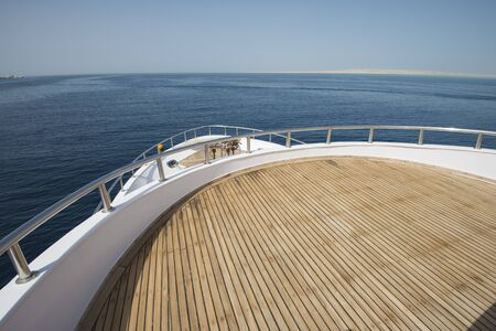 motor yacht: View over the bow of a large luxury motor yacht on tropical open ocean