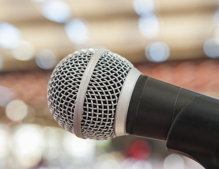 live performance: Closeup detail of a microphone on a stand at a live performance