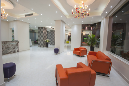 seating area: Interior design of a luxury hotel resort lobby reception area with seating Stock Photo