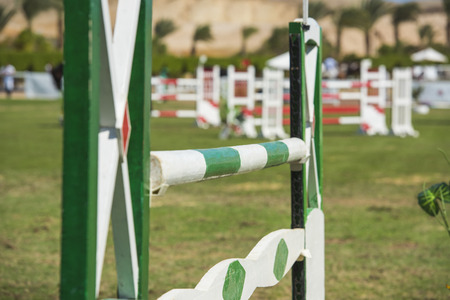 Closeup of a hurdle at an outdoor equestrian showjumping competition event