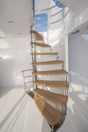 pleasure craft: Wooden curved staircase on sundeck area of large luxury motor yacht